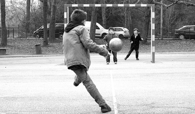 children playing soccer at the park